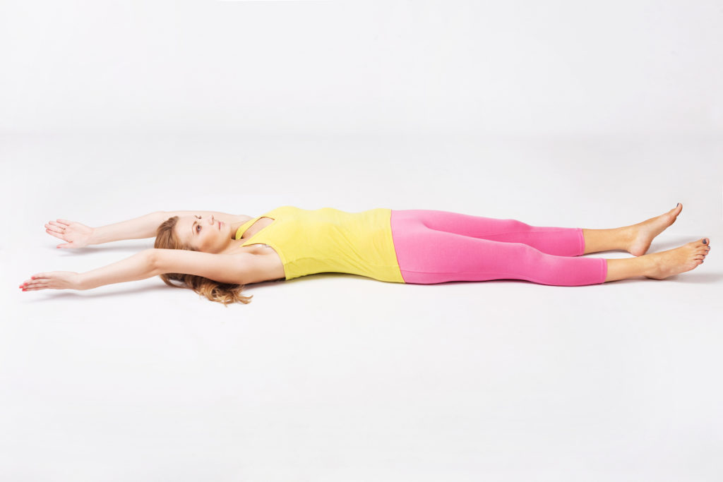 supine stretch post body contouring session Chicago TushToners